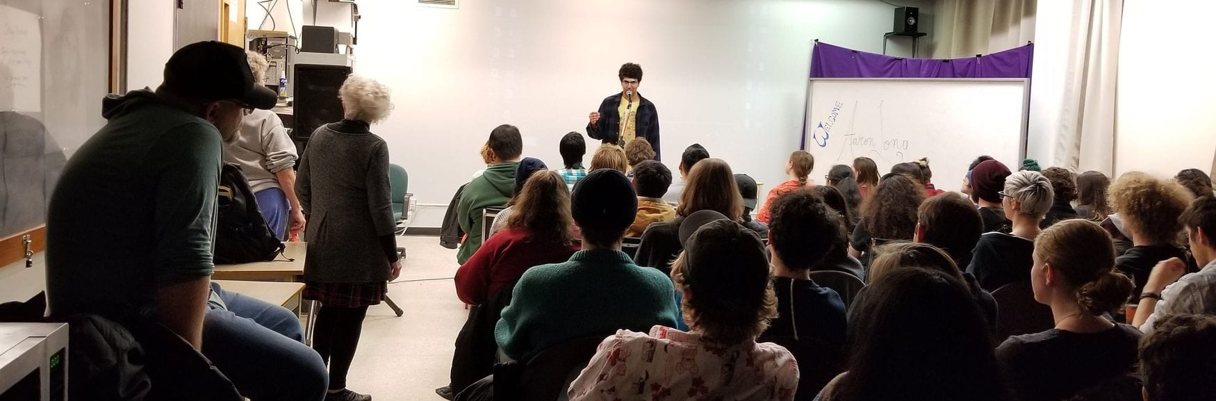 Aaron Long speaking at Max the Mutt College